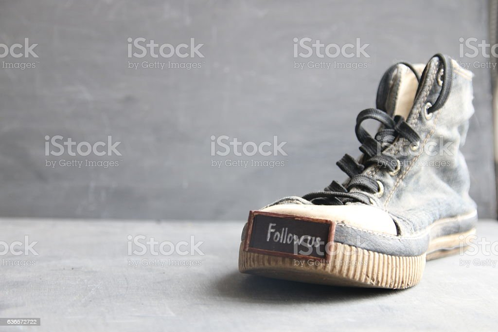 Follow us label for social networks and Vintage Sneakers stock photo