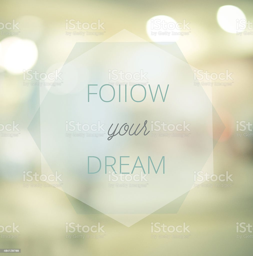 Follow your dreams, Inspirational typographic quote on blur abst stock photo