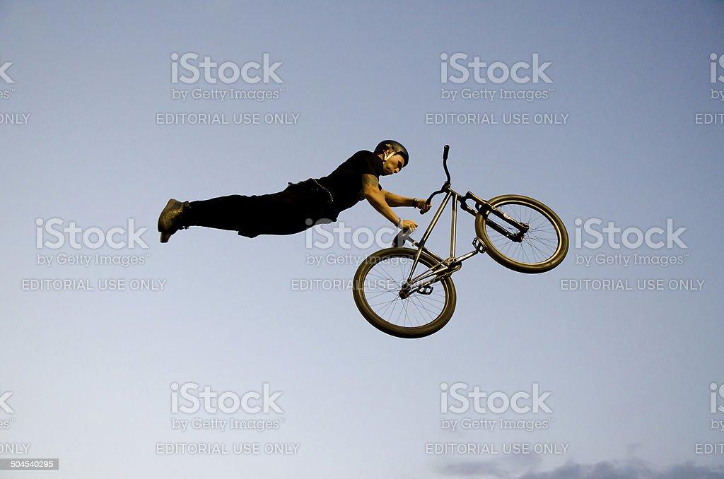Following his bike stock photo