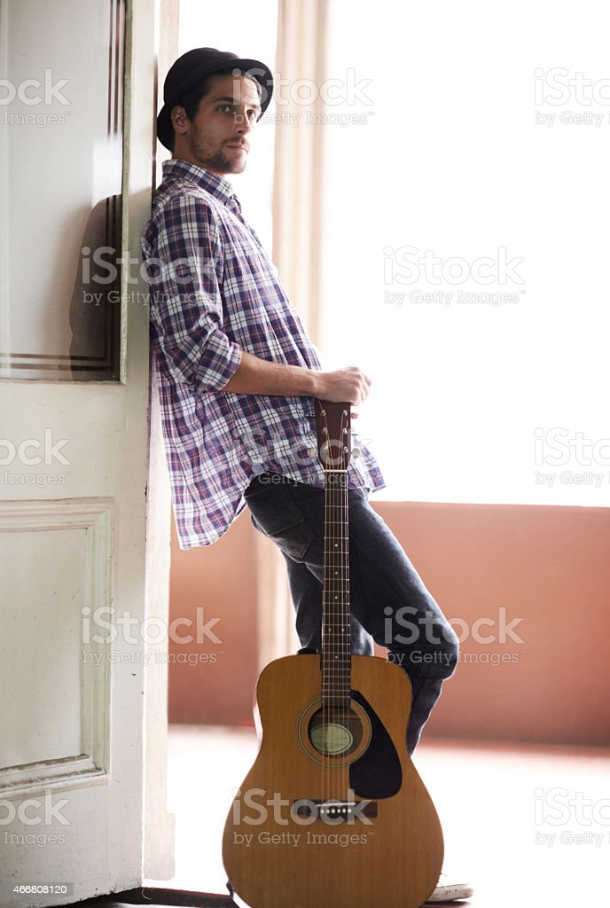 Following his dream of making music stock photo