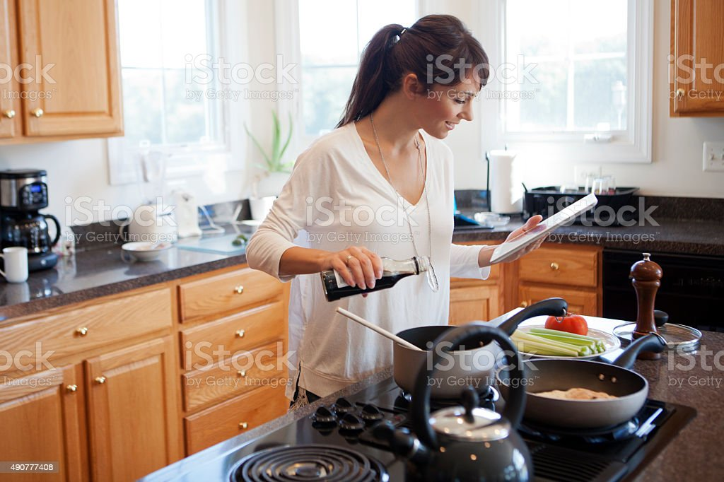 Following recipe on digital tablet stock photo