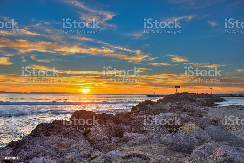 Following the rocks to the sunset. stock photo