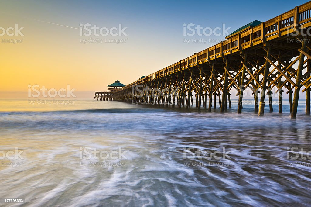 Folly Beach Pier Charleston SC Coast Atlantic Ocean Pastel Sunrise stock photo