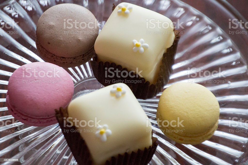 Fondant fancy cakes macaroons with decoration on a clear tray stock photo