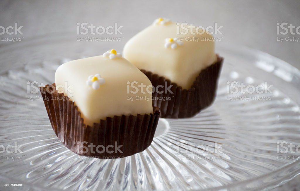 Fondant fancy cakes with decoration on a clear tray stock photo