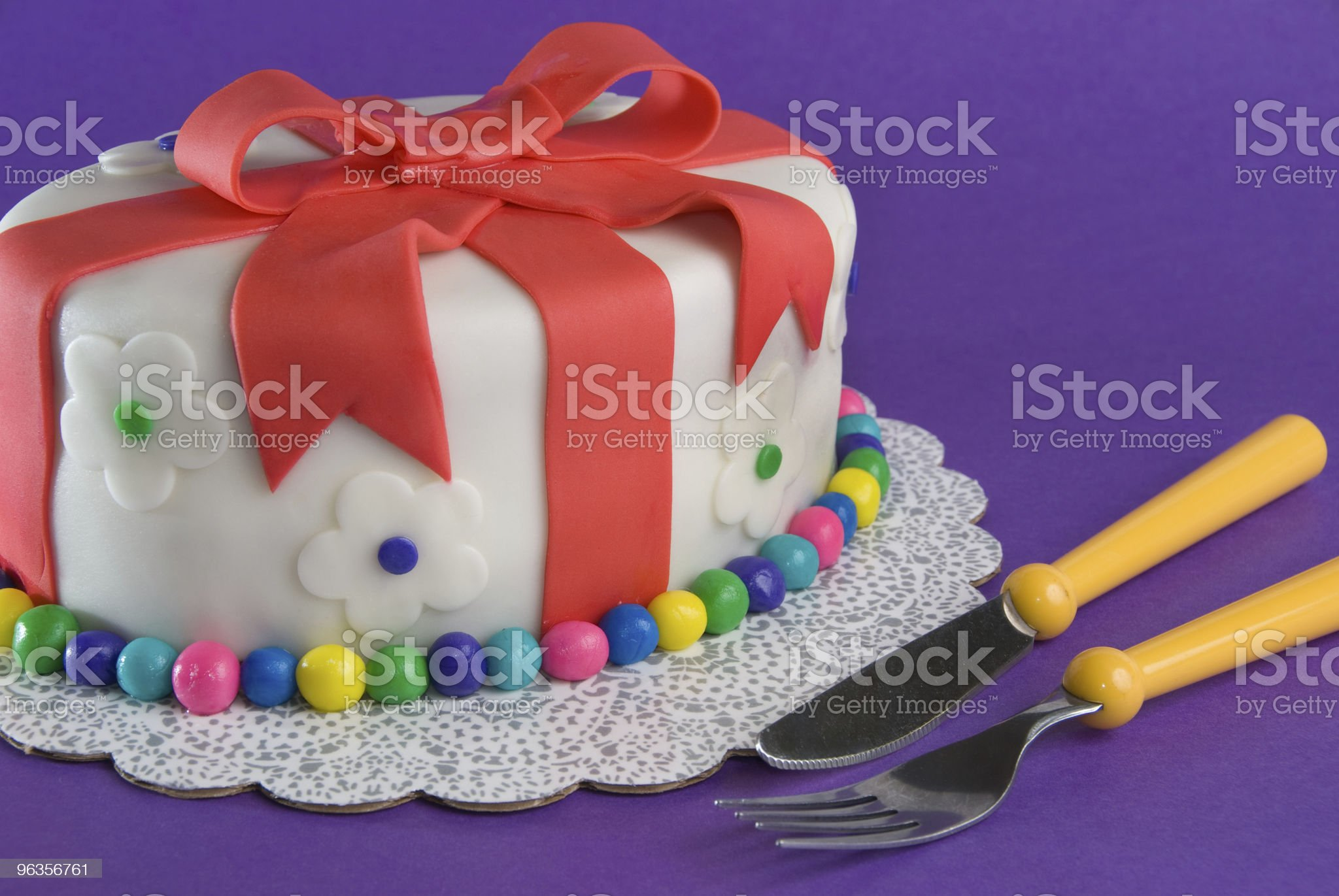 Fondant Gift Cake With Fork and Knife royalty-free stock photo