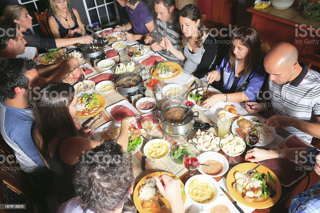 Fondue Dinner - Group Eat royalty-free stock photo