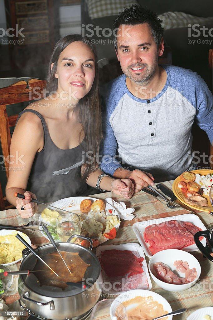 Fondue Dinner - Happy Couple Vertical royalty-free stock photo