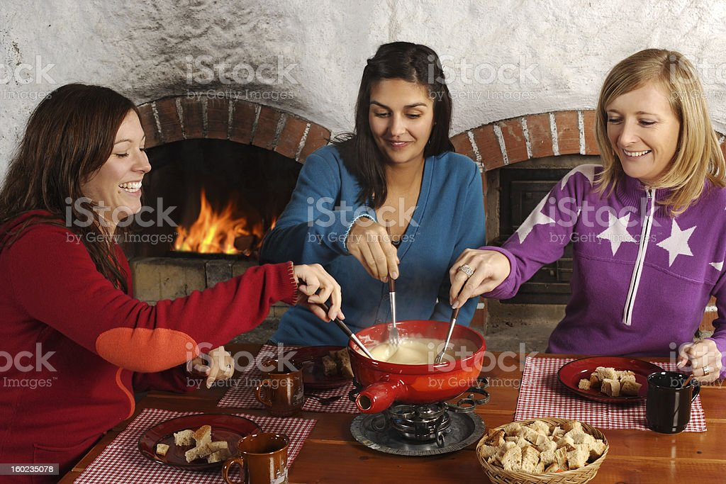 Fondue dinner with friends stock photo