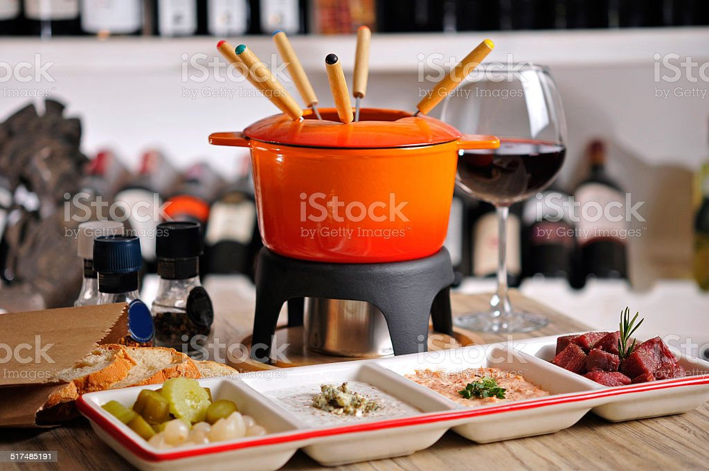 Fondue with appetizer and red wine stock photo