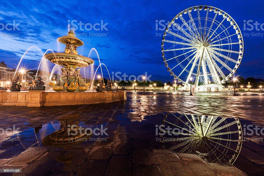 Fontaine des Fleuves and Ferris Wheel in Paris stock photo