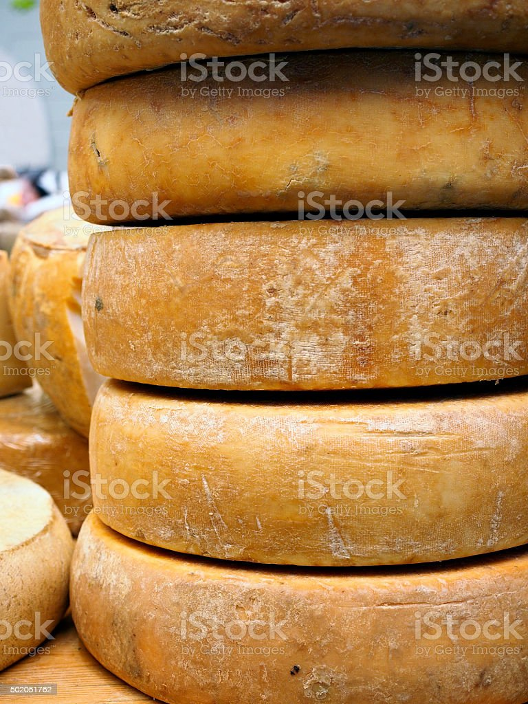 Fontina cheese wheels stock photo