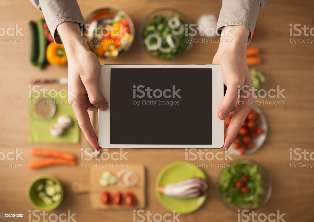 Food and cooking app on digital tablet stock photo