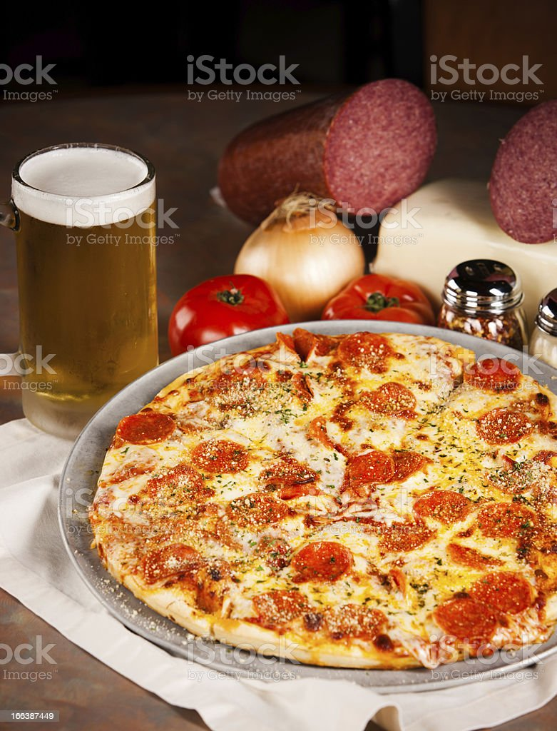 Food and Drink:  Double Pepperoni Pizza with Beer royalty-free stock photo