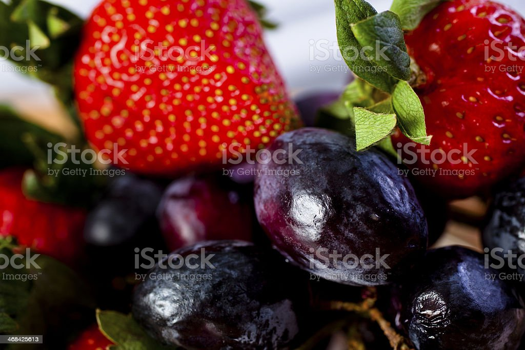 Food and Drink:  Fresh strawberries, grapes.  Close up. royalty-free stock photo