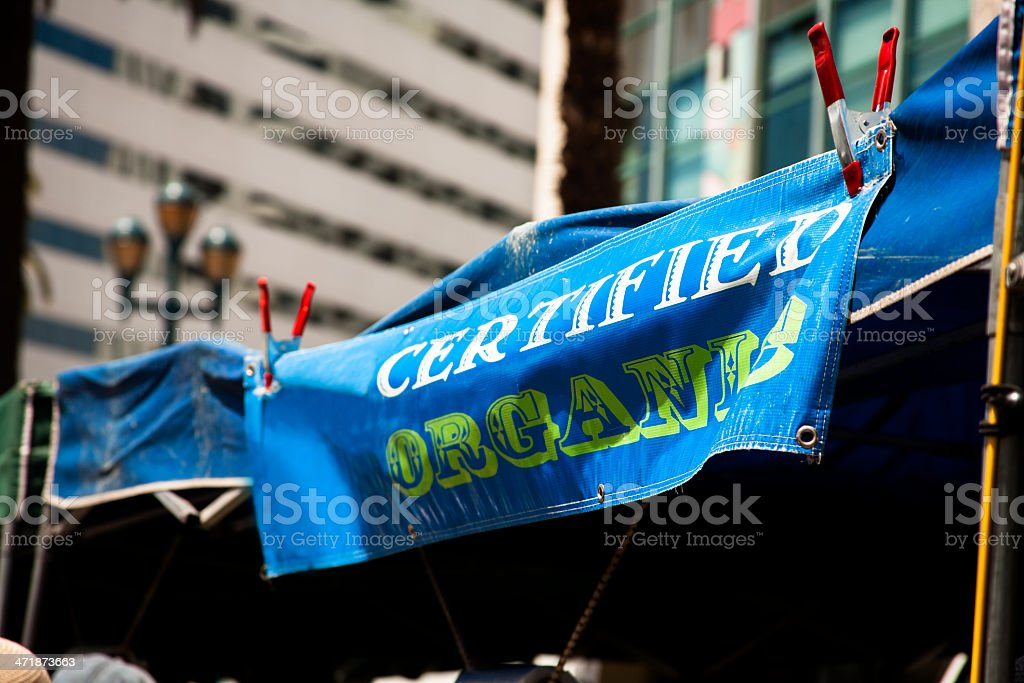 Food and Signs:  'Certified Organic' banner at farmer's market. royalty-free stock photo