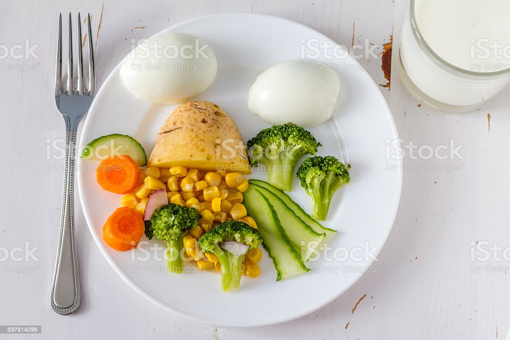 Food arranged to look appealing to kids, milk stock photo