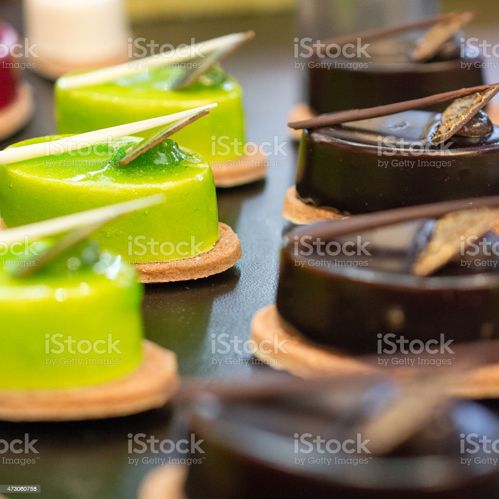 food art Petit fours chocolate and green pistachio stock photo