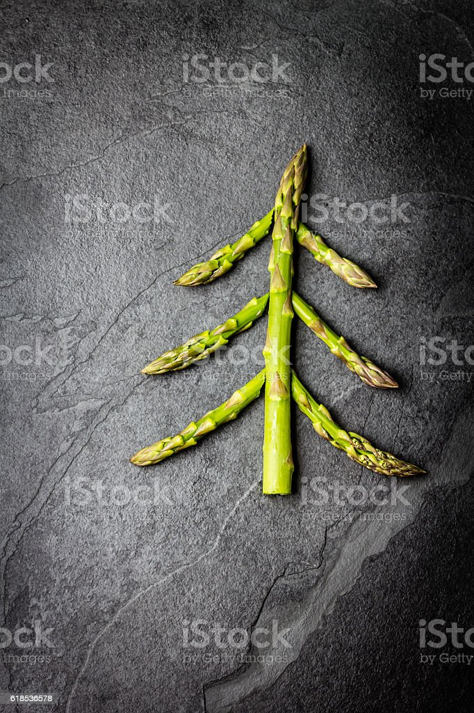 Food background. Christmas tree made from asparagus Healthy holiday concept stock photo