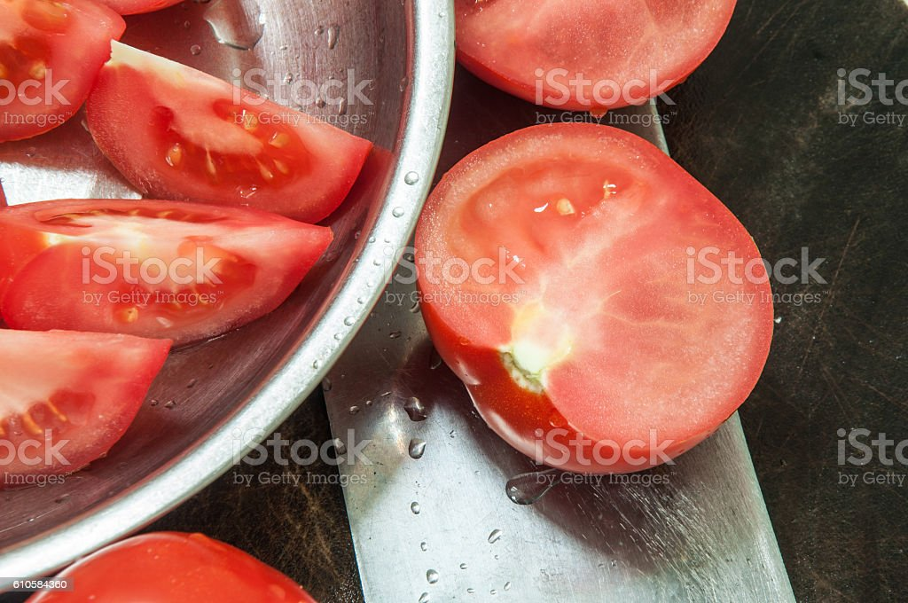 Food background. Kitchen knife with tomatos on the chopping block. stock photo