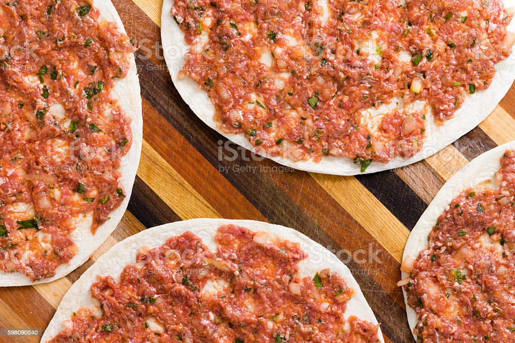 Food background of prepared uncooked lahmacun stock photo