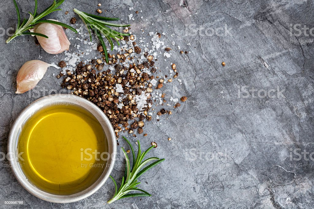 Food Background Olive Oil Salt Peppercorns Rosemary and Garlic o stock photo