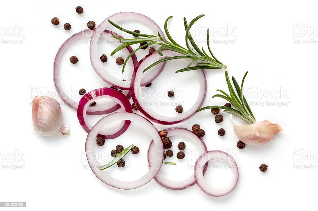 Food Background Onion Rings Peppercorns Rosemary and Garlic Isol stock photo