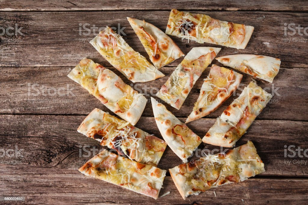 Food background. Pizza slices on table, flat lay stock photo