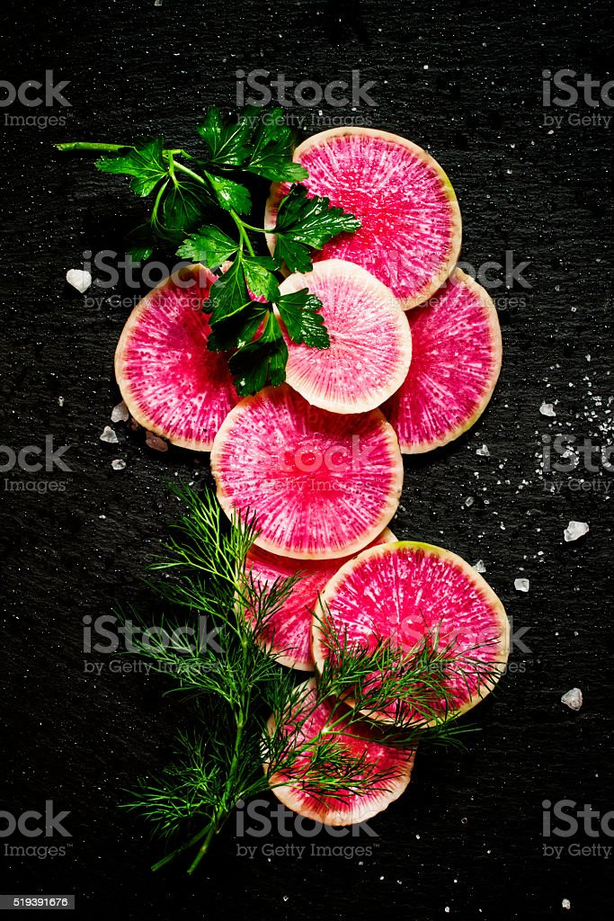 Food background: round slices of watermelon pink radish stock photo