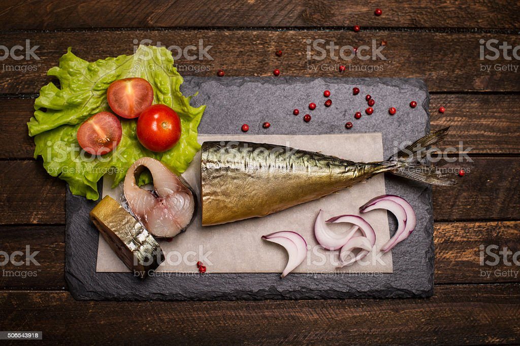 Food background. Smoked mackerel background. Smoked mackerel on slate board. stock photo
