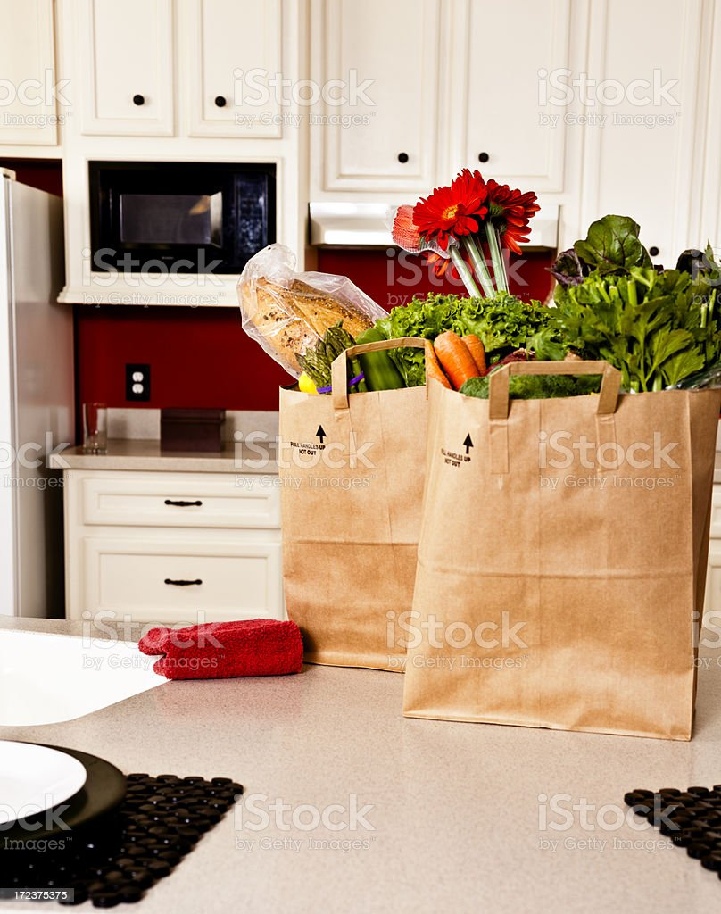 Food:  Bags of groceries on the kitchen counter royalty-free stock photo