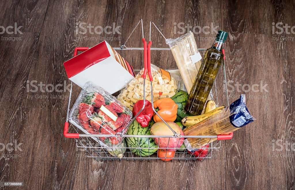 Food basket at the grocery store stock photo