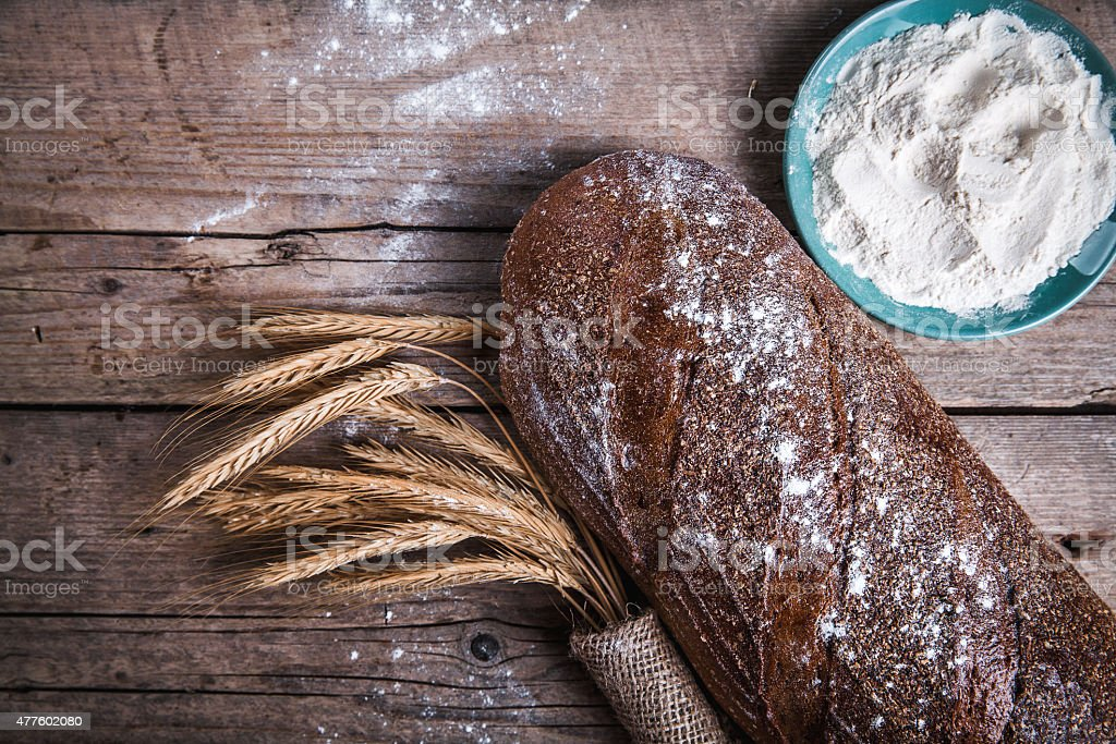 food. beautiful composition of bread, flour and ears stock photo