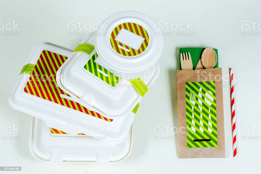 Food boxes and wooden cutlery on white background stock photo