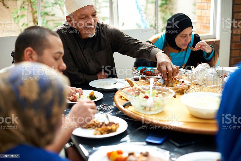 Food brings family together stock photo