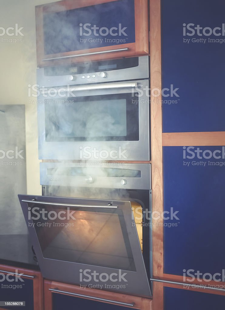Food burning in the oven stock photo