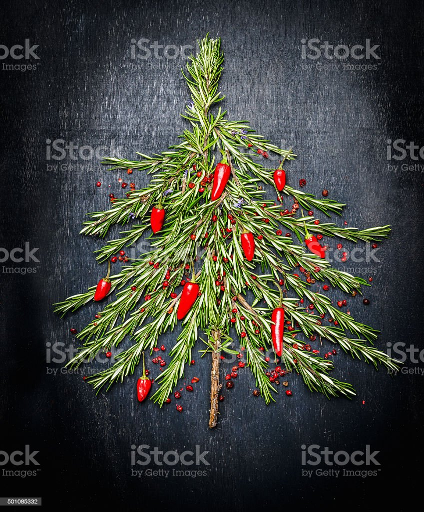 Food Christmas tree  made of fresh rosemary and red chili stock photo