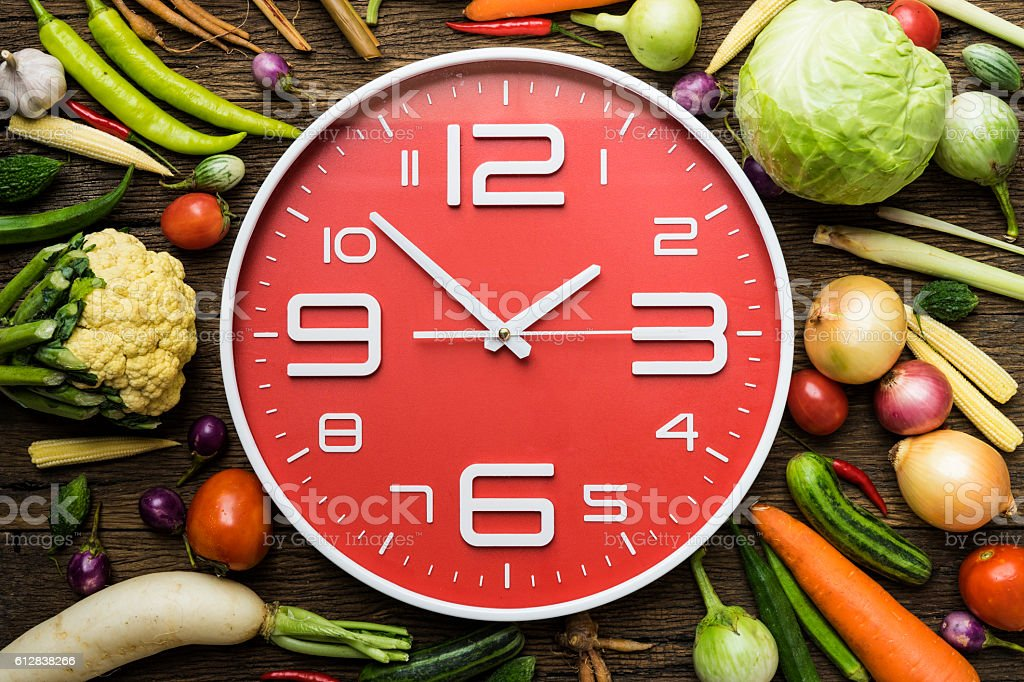 Food clock. Healthy food concept on wooden table stock photo