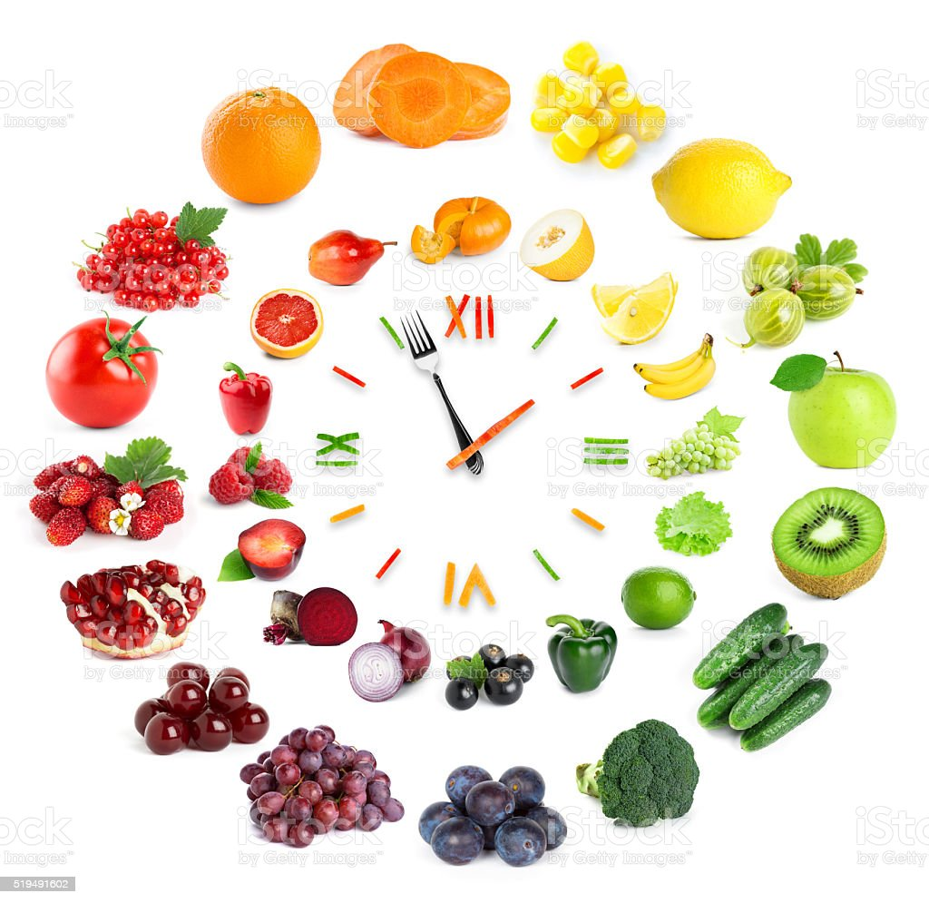 Food clock with fruits and vegetables stock photo