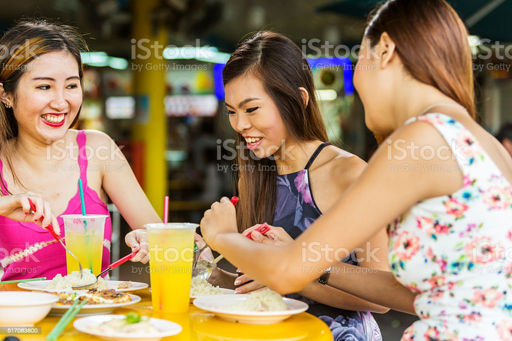 Food Court Meal for Happy Young Women in Singapore stock photo