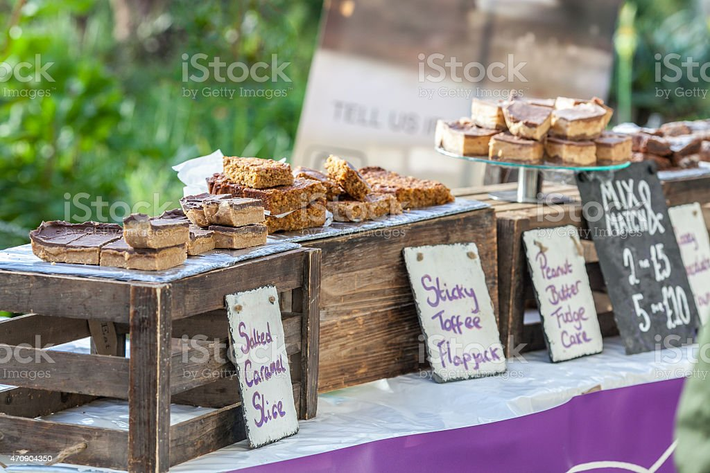 Food fair cake stall selling home made cakes and treats. stock photo