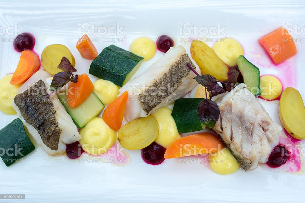 Food : Fish and vegetables design on plate stock photo