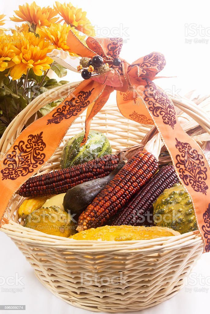 Food gourds and indian corn in a wooden basket stock photo