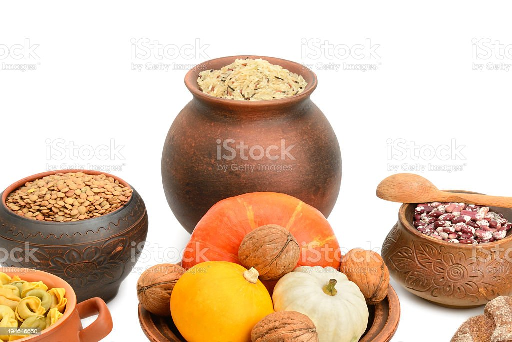 food in a ceramic pot stock photo