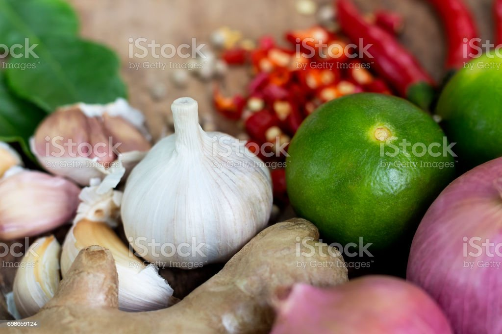 Food ingredient ginger ,chili pepper and  garlic on wooden table, Asian food cooking concept. stock photo