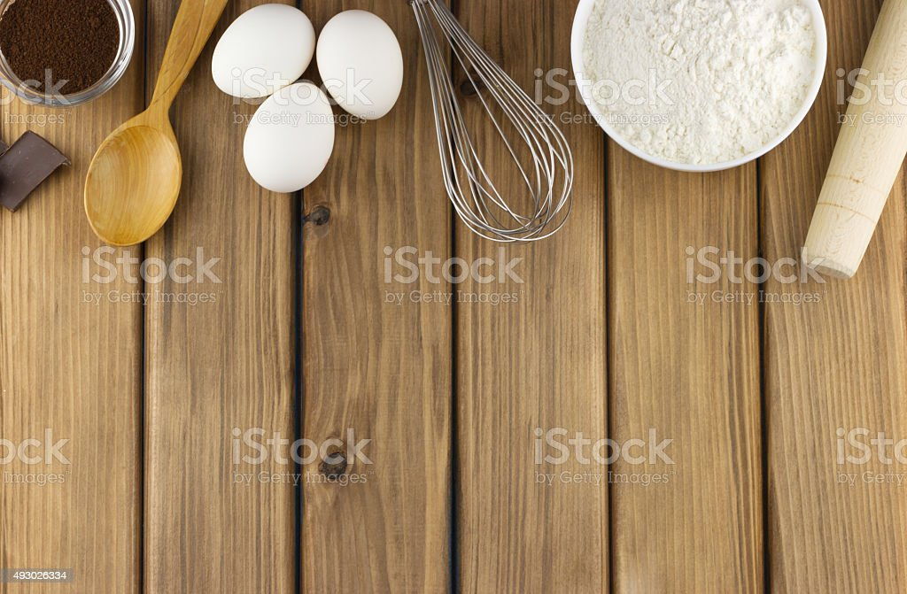 Food ingredients and kitchen utensils for cooking on wooden background stock photo