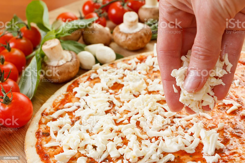 Food ingredients for pizza on table close up stock photo