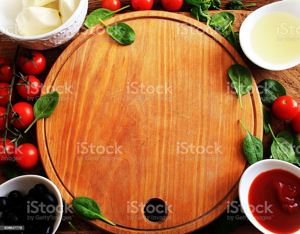 Food ingredients for pizza on wooden table. Top view. stock photo