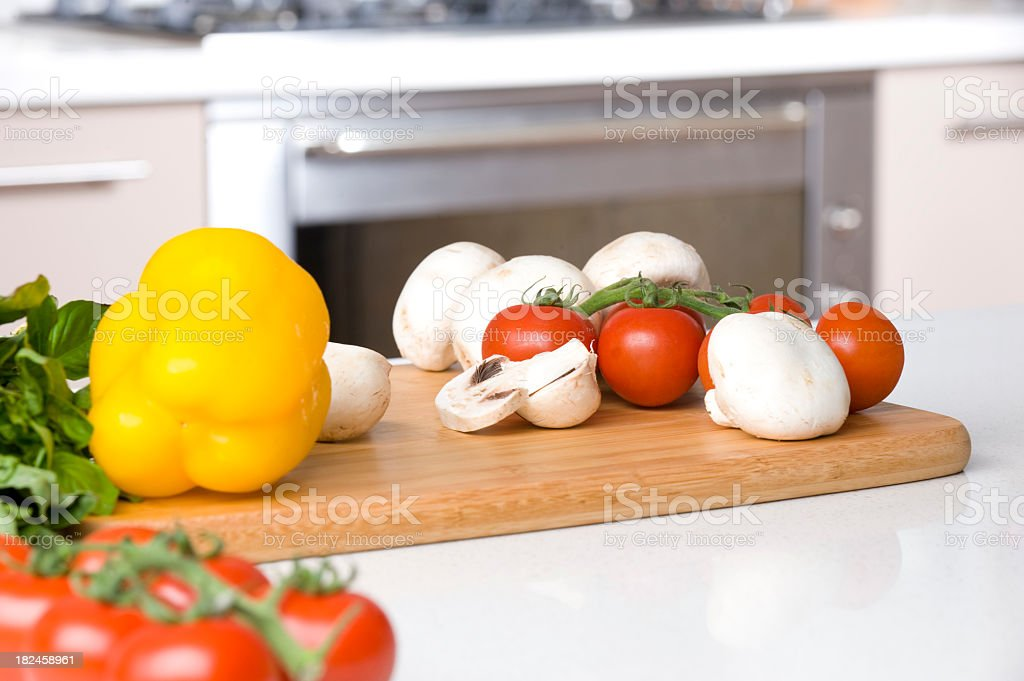 Food ingredients on chopping board in a kitchen royalty-free stock photo