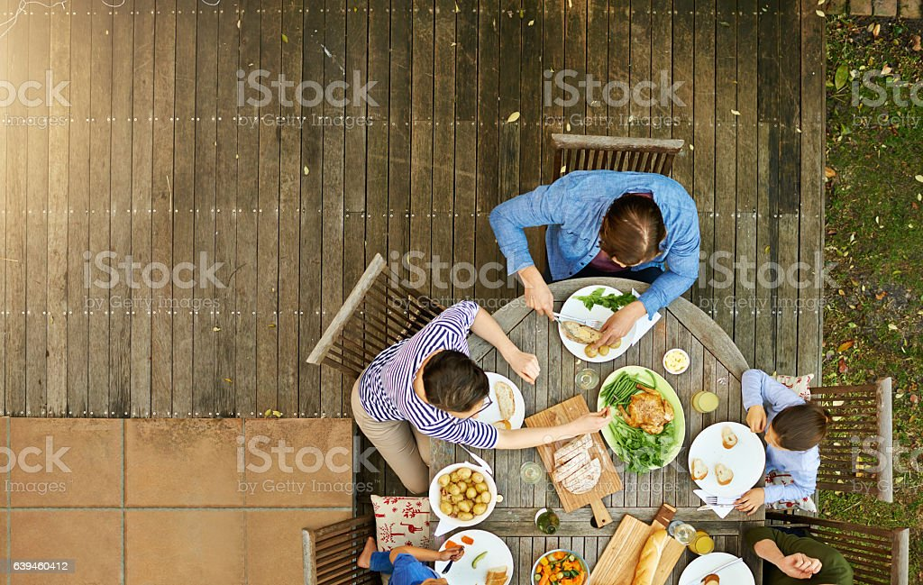 Food is at the heart of this family stock photo